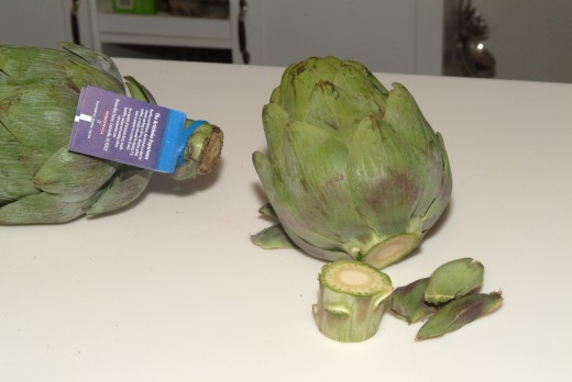 Trim the stems and pull off the tiny superficial  leaves from the base of the artichoke.