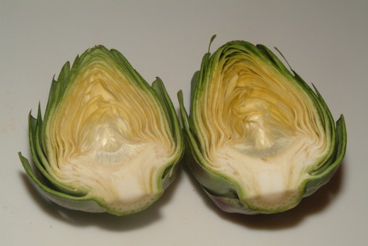 You can slice the artichokes in half and serve two halves to each diner, or steam them whole, serving one whole artichoke per person.