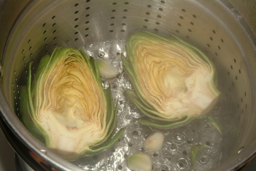 Toss a couple of whole garlic cloves into the steamer for an added, yet mild, flavor in your artichokes.