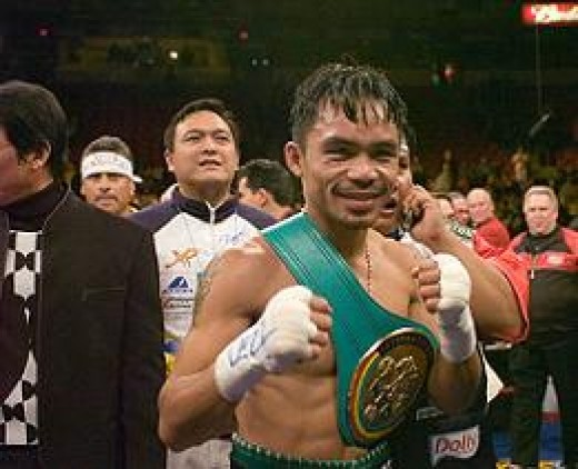 Pacuiao with his winning belt
