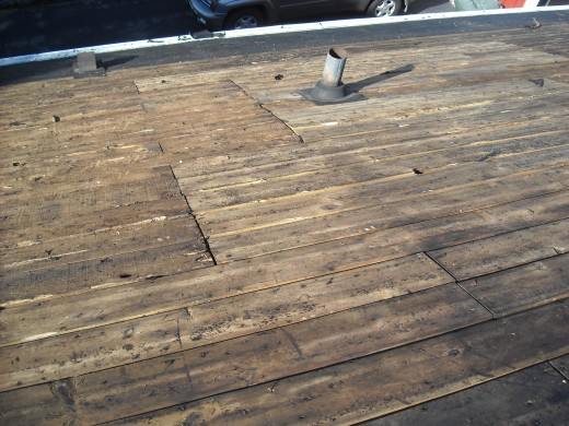 This roof deck has had a lot of boards replaced in the past.  This is a good sign of past water damage that could have damaged the roof structure.