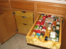 Spices and all my kitchen items are in drawers to easy locate without having to bend or stoop down to look under the cabinets.