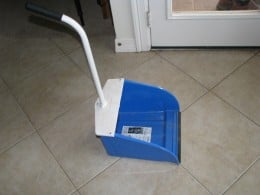 Long handle dust pan, that I use in the house, garage or outside.