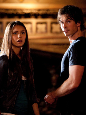 "Nina Dobrev and Ian Somerhalder as Elena Gilbert and Damon Salvatore in episode 1x01 ""Night of the Comet"""
