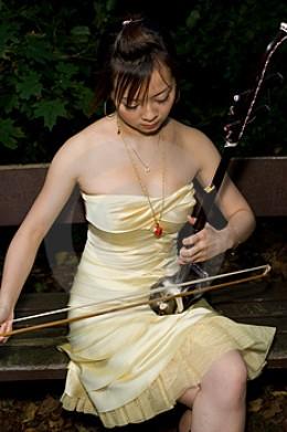 Woman playing Erhu