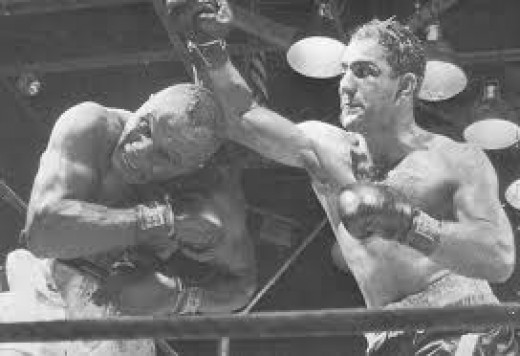 The legendary Rocky Marciano in your right...
