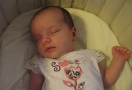 Sweet Evie was born in 2008 and got a quilt of her own from her grandmother. The crib quilt in the next photo is a keepsake and a seek and find quilt, made with scraps of colorful printed fabrics from grandma's vast collection.