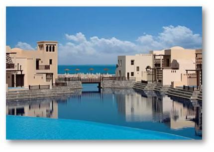 Cove Rotana Resort, greek-inspired hotel resort down the mountain side of Ras Al Khaimah