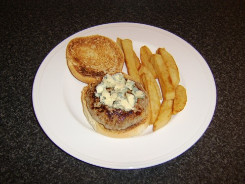 Stilton cheese is crumbled over the pork and apple burger