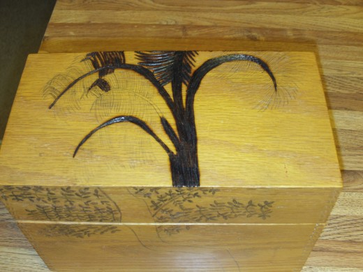 Here is another picture of the palm tree I am wood burning on the top of a wood box.