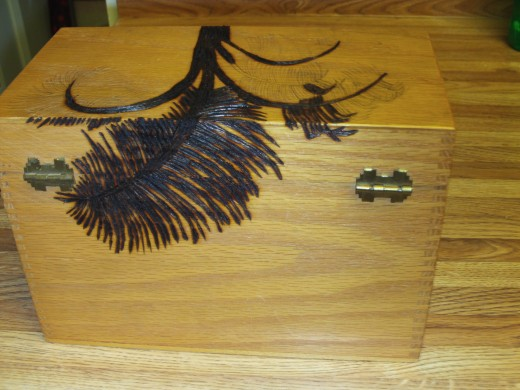 Here is a picture showing what the entire wood burned palm frond looks like on the back of the box.