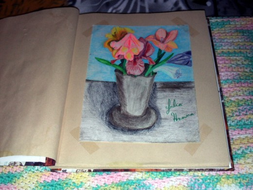 Here is a picture out of a page in my art scrapbook.  The sketch featured here is of a vase of flowers that I drew back in 2000.