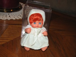 Just a cute little red-headed doll.
