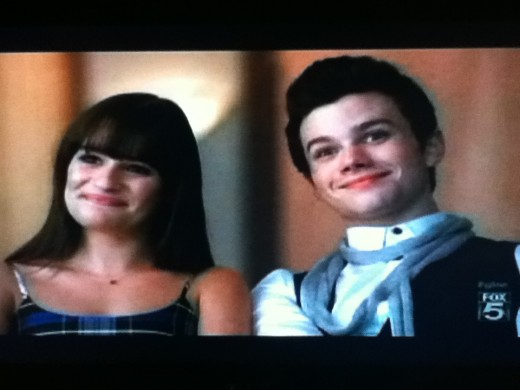 Smiles frozen in place, Rachel and Kurt watch as their dreams are shattered before their eyes.