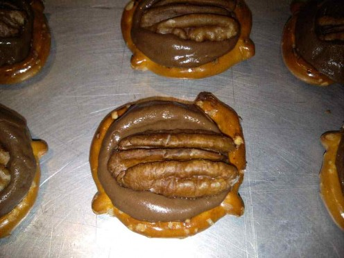 Press a pecan onto a melted Rolo and a mini pretzel twist and you have a great little treat!