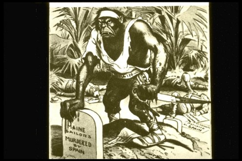 """The """"Spanish Ape"""" hunkers over the graves of the Maine's sailors in one of many political cartoons that aroused American fury over the tragedy."""
