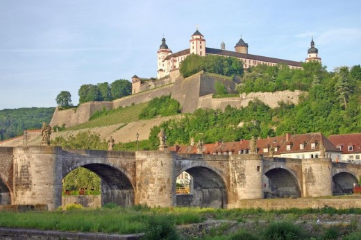 Festung Marienburg or Marienburg Fortress overlooking the city of Wurzburg, Germany, and the Alte Mainebruke or the old Maine River Bridge spanning the river.