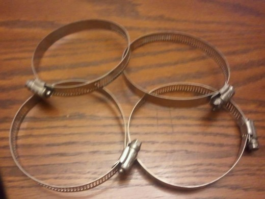 4 pipe clamps that are a bit bigger than the cups. $4 for 4.