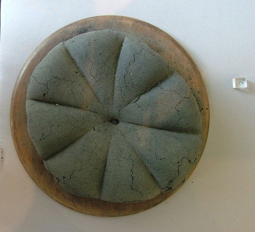 Ancient Roman loaf of bread found at Pomepii. ; this bread came from the actual scene of Pompeii where the volcano struck.