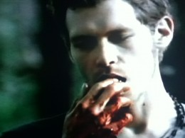 Klaus takes a moment after killing a werewolf to savor the kill.