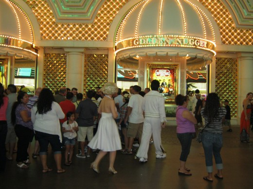 """Elvis"" and ""Marilyn Monroe"" walking Fremont Street."