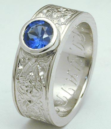 Platinum ring w/ bezel-set sapphire