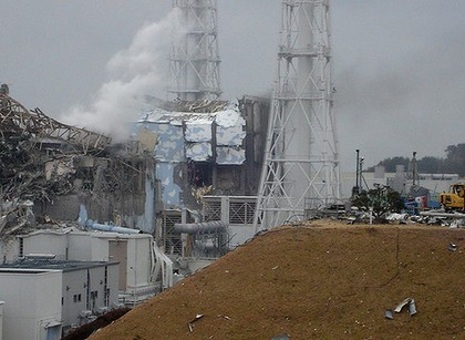 Smoke rises from the damaged nuclear reactor at Fukushima