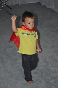 super Max - running around the house saying cool! He really enjoyed his cape.
