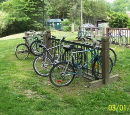 Many people ride bicycles to save money and become healthier.