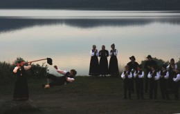 Young boy performing a hallinkast (kick the hat maneuver) in a dancing scene from an outdoors performance of Peer Gynt at Gaalaavannet.  Photo credit:  Marcus Ramberg.