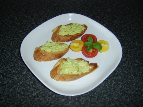 Guacamole spread on bruschetta makes an excellent starter or appetizer