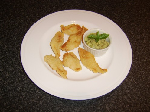 The whiting is cut in to wedges, dipped in batter and deep fried before being served with a guacamole dip