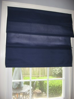 Navy Roman Shade.  Matching Shade on kitchen door.