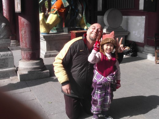 This girls parents wanted to have a picture of their daughter and me in China. Children love the puppets an like to have their photos taken with them.