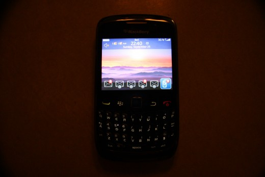 "Blackberry device with full mobile network connection and message notifiers. Note the 3G and 'dots"" in the top right."