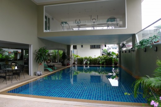 Swimming pool and small fitness center at Boss Suites