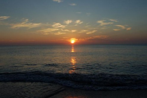 Sunrise at the beach is truly beautiful. On the ocean side of Florida, the sunrises are fantastic.  I often walk along the beach, early in the morning, watching the sun come up, collecting shells with my daughter, taking pictures.    photo by AMB
