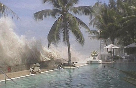 A tidal wave is recorded crashing into the wall next to a swimming pool after the Indian Ocean tsunami on Boxing Day 2004