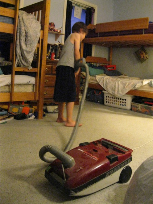 Chid having initiative to clean his room.