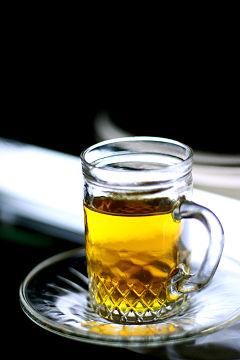 A delicious glass of golden cinnamon tea