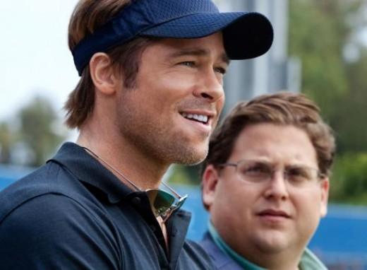 Brad Pitt as Billy Beane and Jonah Hill as Peter Brand