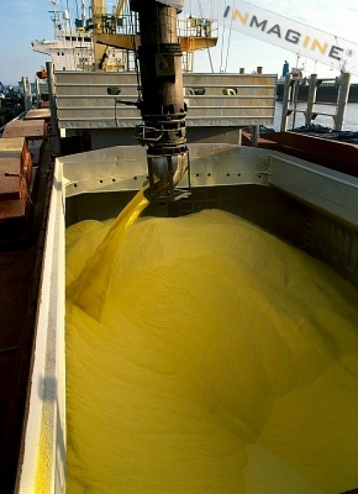 Sulfur being loaded in a ship