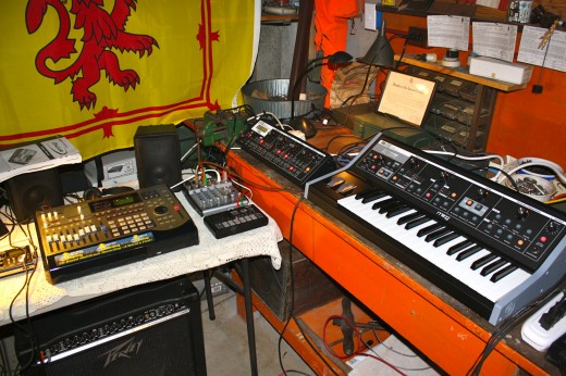 Moog equipment, mixing board, drum machine and partially shown Roland DiscLab.