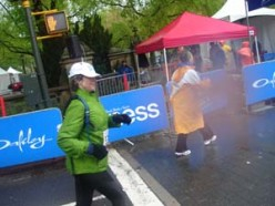 I am passing by my husband and son as I approach the finish line.