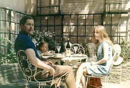 Lord and Lady Lucan with one of their little girls at home, in their garden.