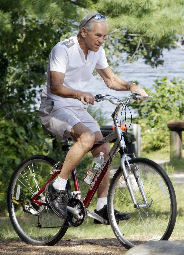 Congressman Ron Paul riding a bike