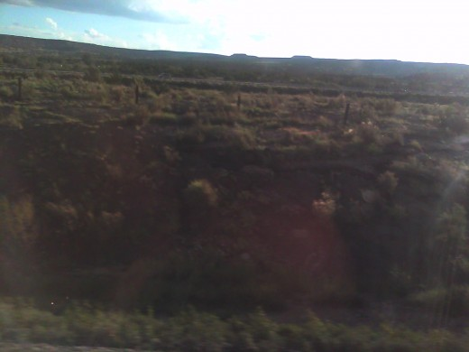 vague picture of coal being pushed up from the ground in New Mexico