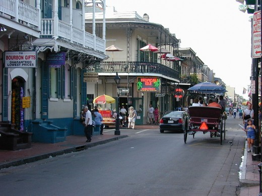 Bourbon Street is an exotic street where almost anything or anyone may come walking along. You can also take a horse drawn carriage ride around the French Quarter including Bourbon Street.