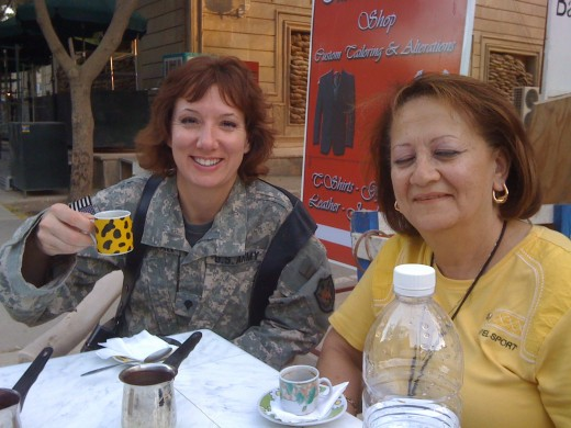An interpreter  and I (left) share Turkish coffee in Baghdad.