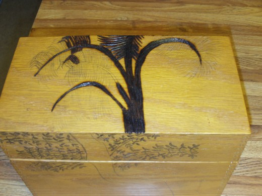 I am beginning to wood burn the palm tree on the top of the box.
